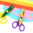 Colorful zigzag scissors with color paper isolated on white - ストック写真