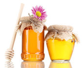 Sweet honey in jars with drizzler isolated on white — Stock Photo