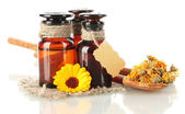 Medicine bottles and calendula, isolated on white — Stock Photo