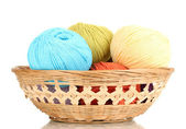 Knitting yarn in basket isolated on white — Stock Photo