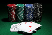 Cards and chips for poker on green table — Stock Photo