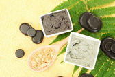 Cosmetic clay for spa treatments on yellow background close-up — Stock Photo