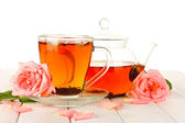 Teapot and cup of tea with roses on white wooden table — Stock Photo