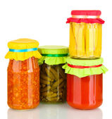Jar with canned cucumbers, corn, lecho and tomato paste isolated on white — Stock Photo