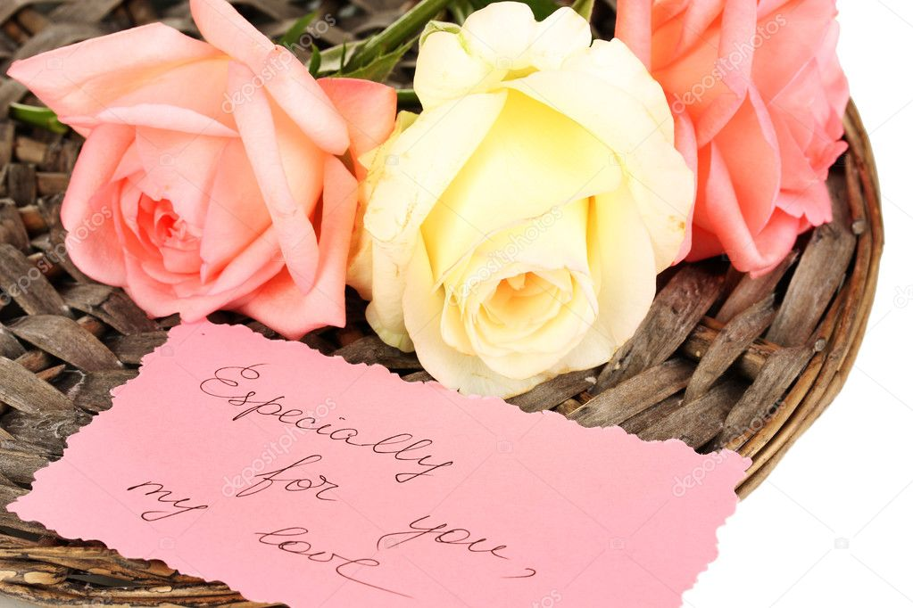 Beautiful roses on wicker mat with card isolated on white — Stock Photo #11927358