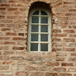 Brick wall background with window - Stock Photo
