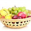 Mix of ripe sweet fruits and berries in basket isolated on white — Stock Photo