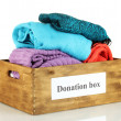 Donation box with clothing isolated on white — Stock Photo #11941941