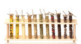 Various spices in tubes isolated on white — Stock Photo