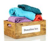 Donation box with clothing isolated on white — Stock Photo
