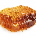 Sweet honeycomb with honey, isolated on white — Stock Photo