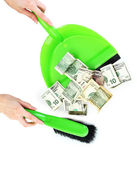 Sweeps money in the shovel on white background close-up — Stock Photo