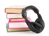 Headphones on books isolated on white — Stock Photo
