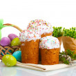 Beautiful Easter cakes, colorful eggs in basket and pussy-willow twigs isolated on white — Stock Photo #11961634