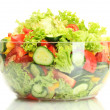 Fresh vegetable salad in transparent bowl isolated on white — Stock Photo #11961851