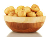 Young potatoes in a wooden bowl isolated on white — Stock Photo