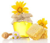 Sweet honey in jar with honeycomb, wooden drizzler and flowers isolated on white — Stock Photo