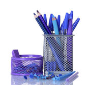 Color holders for office supplies with them isolated on white — Stock Photo