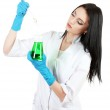 Young female scientist holding test-tube isolated on white — Stock Photo #12033387