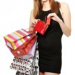 Beautiful young woman with shopping bags and credit card isolated on white — Stockfoto