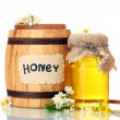 Sweet honey in barrel and jar with acacia flowers isolated on white - Stock Photo
