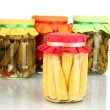 Jars with canned vegetables isolated on white - Stock Photo