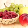 Ripe sweet fruits and berries on wooden background — Stock Photo