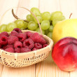 Stock Photo: Ripe sweet fruits and berries on wooden background