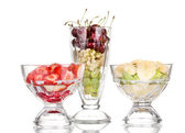 Mixed fruits and berries in glasses isolated on white — Stock Photo