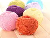 Knitting yarn on wooden background — Stock Photo