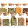 Powder spices in glass jars isolated on white — Stock Photo #12066344