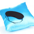 Stock Photo: Sleeping mask on pillow isolated on white