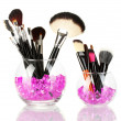 Make-up brushes in two bowls with stones isolated on white - Stock Photo
