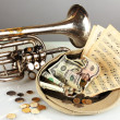 Musical instrument with money on gray background — ストック写真