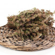 Thyme herb on wicker mat isolated on white - Stockfoto