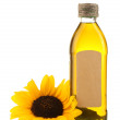 Oil in bottle and sunflower, isolated on white — Стоковая фотография