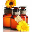 Medicine bottles and beautiful calendula flowers, isolated on white — Stock Photo #12066868