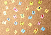 Many question marks on cork board — Stock Photo