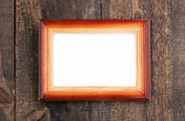 Wooden frame on wooden background — Stock Photo