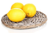 Lemons in a board isolated on white — Stock Photo