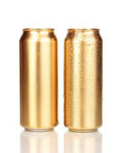 Golden cans isolated on white — Stock Photo
