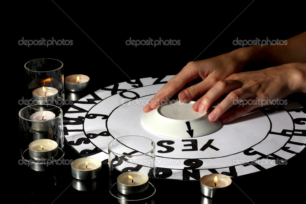 Spiritualistic seance by candlelight close-up — Stock Photo #12066737