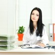 Beautiful girl doctor in the office — Stock Photo #12089683
