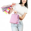 Beautiful young girl holding bright bags isolated on white — Stock Photo #12089690