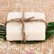 Hand-made herbal soap on sackcloth — Photo