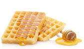 Belgium waffles with honey isolated on white — Stock Photo