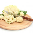 Fresh cauliflower and knife on cutting board isolated on white — Stock Photo #12090093