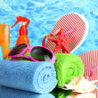 Bright beach accessories, on blue sea background — Stock Photo #12090369