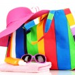 Beach bag with accessories isolated on white - Stockfoto