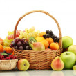 Assortment of exotic fruits and berries in baskets isolated on white — Stock Photo #12090667